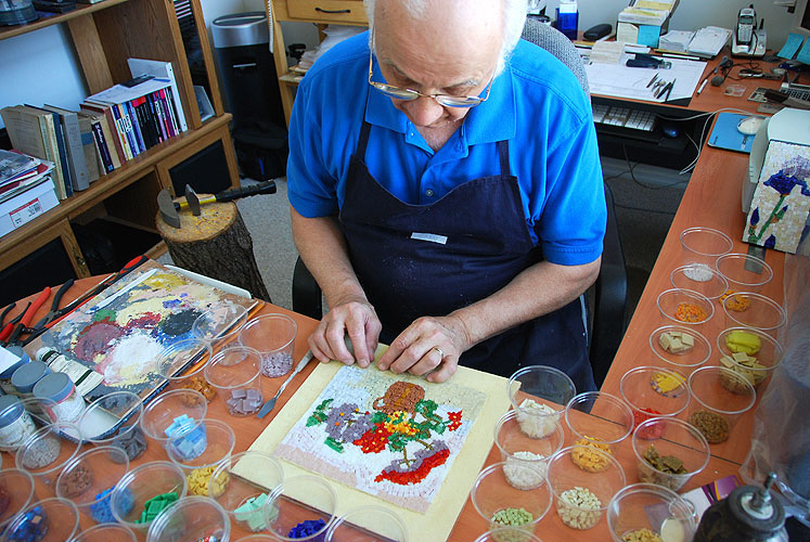 Jerry Reynolds working on floral mosaic
